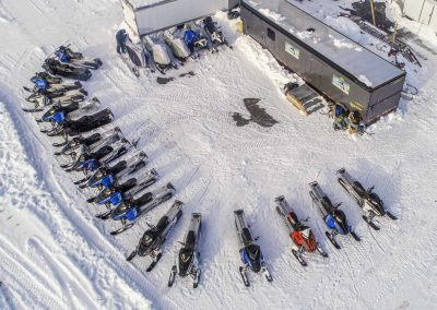 dozens of snowmobiles ready to ride colorado snow