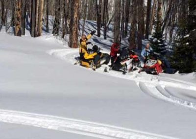 snowmobiling in deep snow