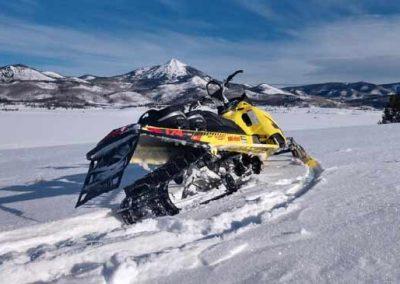 snowmobile in deep powder snow